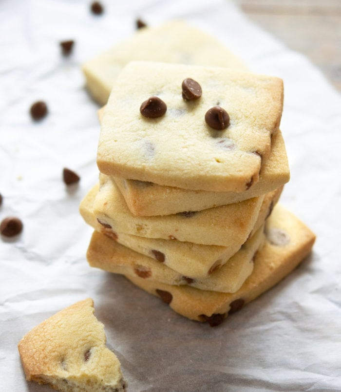 overhead photo of a stack of chocolate chip shortbread cookeis