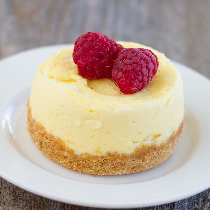 close-up photo of a cheesecake topped with raspberries