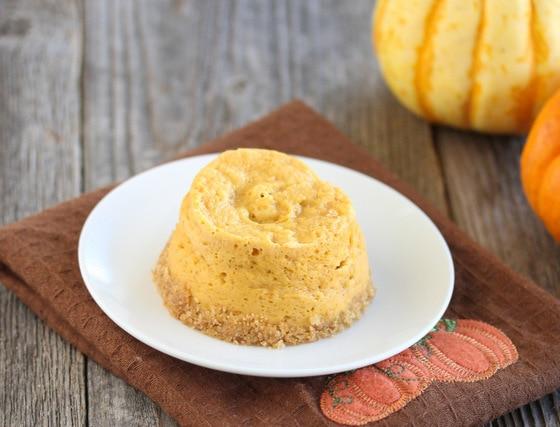 photo of a mini pumpkin cheesecake on a plate