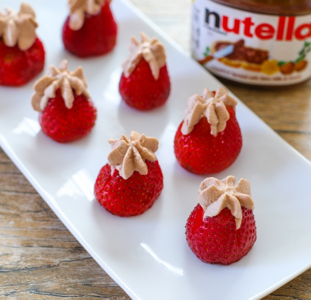 photo of nutella cream stuffed strawberries