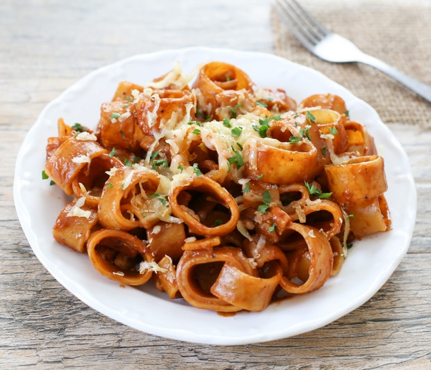 photo of bbq chicken pasta on a white plate