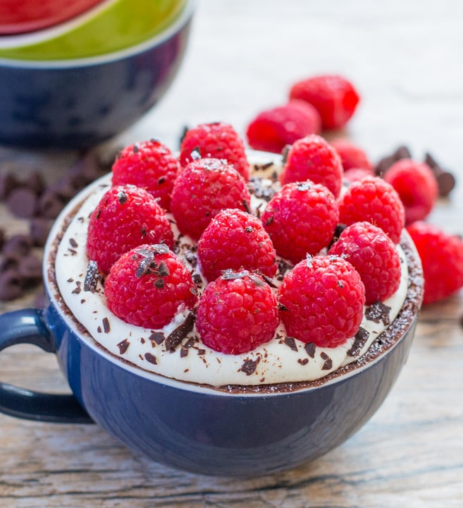Chocolate Mug Cake garnished with fresh raspberries