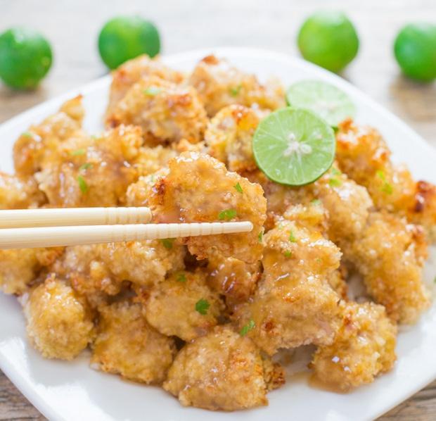 photo of chopsticks grabbing a piece of chicken