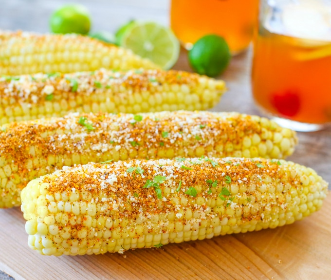 photo of Mexican-Style Grilled Corn on a cutting board