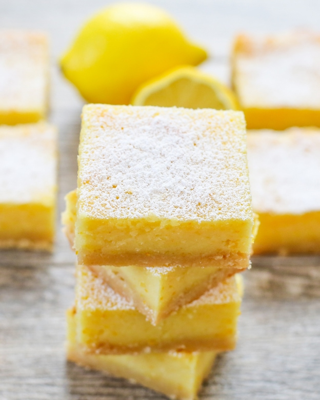 whole lemon bars dusted with powdered sugar