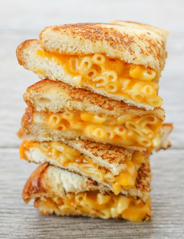 a stack of grilled macaroni and cheese sandwiches