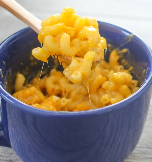 spoonful of microwave macaroni and cheese in a mug