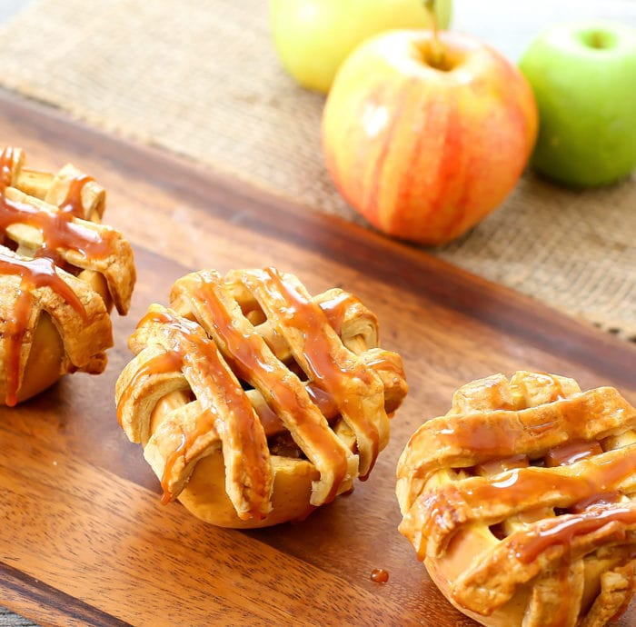 close-up photos of apple pies baked in apples