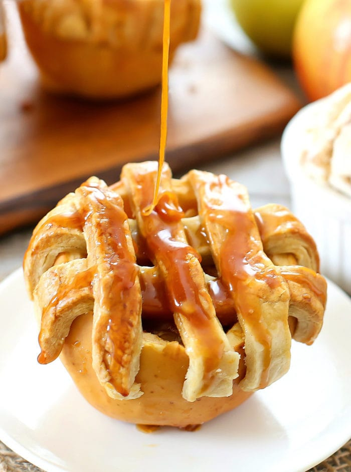 photo of salted caramel sauce being poured over an apple pie baked in an apple