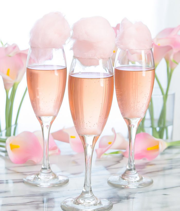 photo of glasses of champagne topped with cotton candy