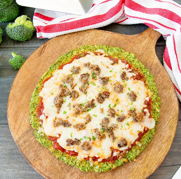 top-down photo of one broccoli crust pizza on a pizza peel