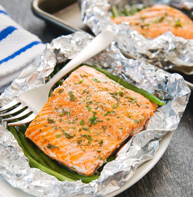 close-up photo of salmon in a foil packet