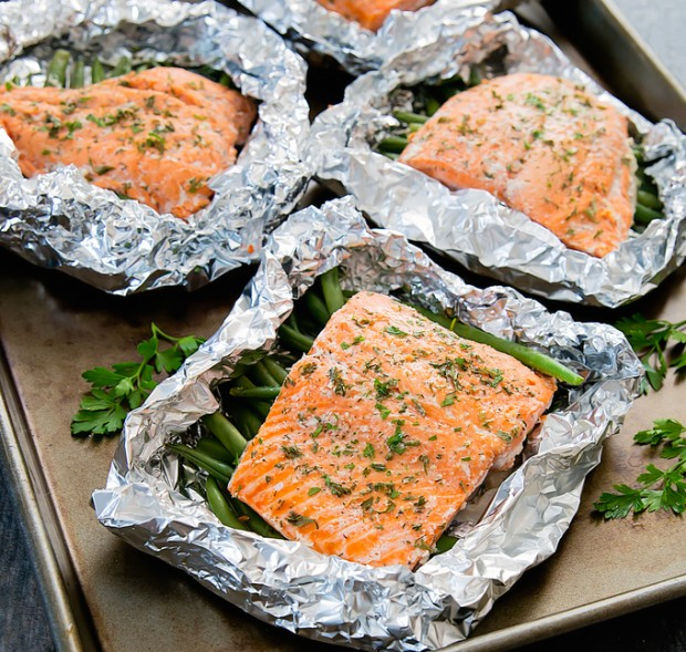 photo of three salmon packets on a sheet pan