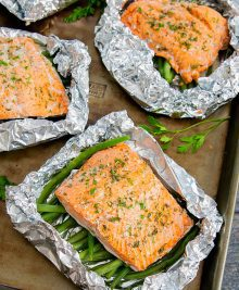 overhead photo of Ranch Seasoned Salmon Foil Packets on a sheet pan