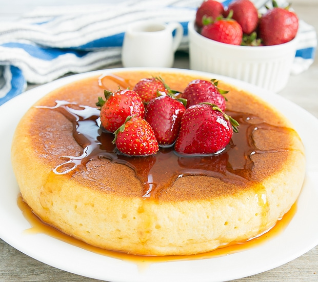 photo of a Rice Cooker Pancake with syrup and fresh strawberries