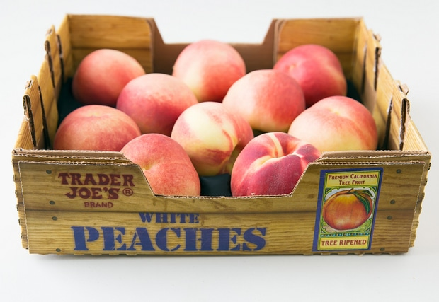 a crate of White Peaches
