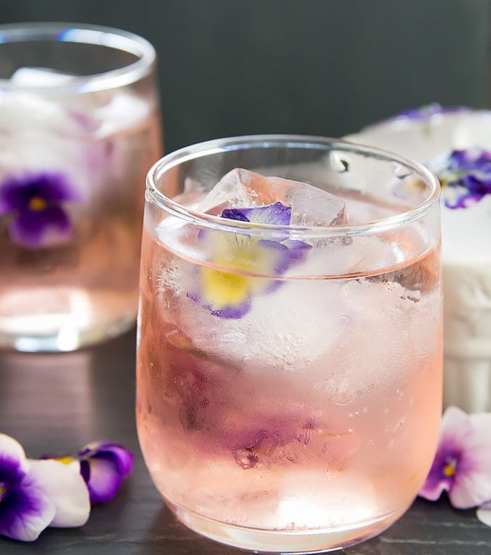 close-up photo of a drink with Edible Flower Ice Cubes