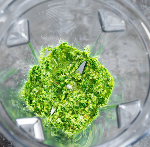 overhead photo of pesto in a blender