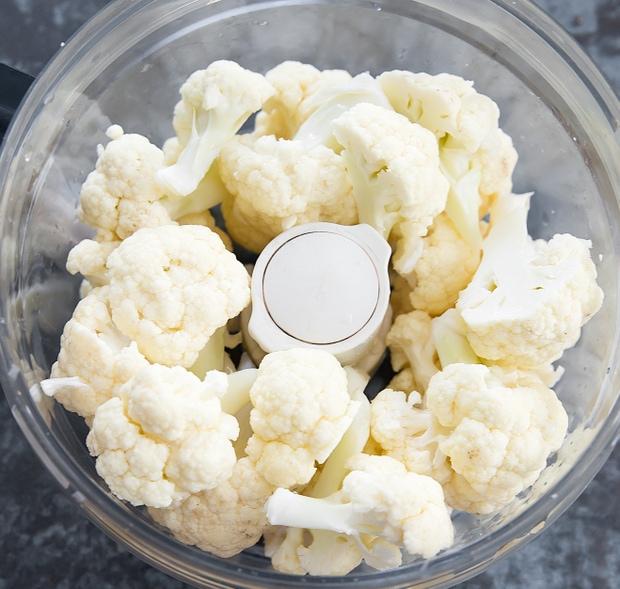 photo of cauliflower florets in a food processor