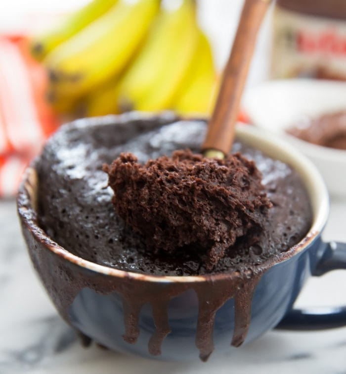 photo of of a spoon scooping out a bite of flourless nutella banana mug cake