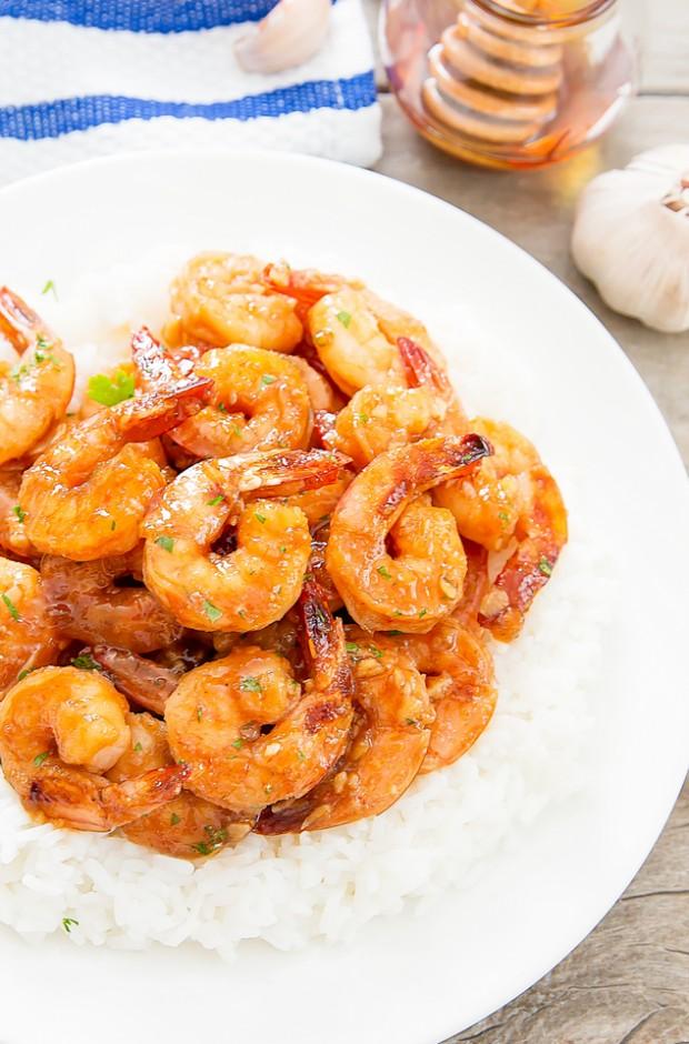 overhead photo of Honey Garlic Shrimp on a white plate