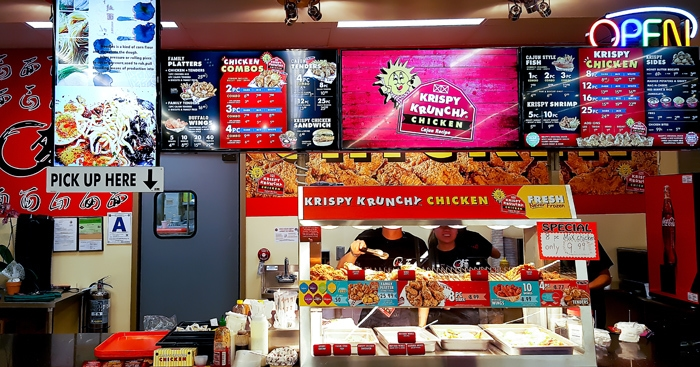 photo of the order and pick-up counter at Krispy Krunchy Chicken