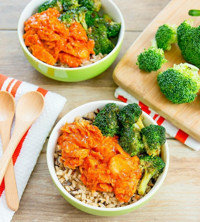overhead photo of two Sriracha Salmon & Teriyaki Broccoli Bowls