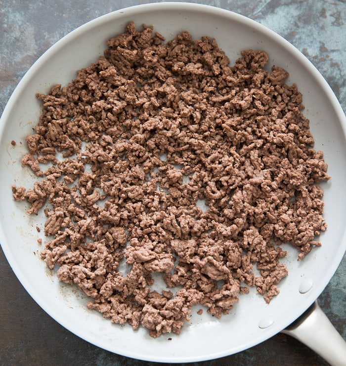 step by step photo of cooked ground beef in a skillet