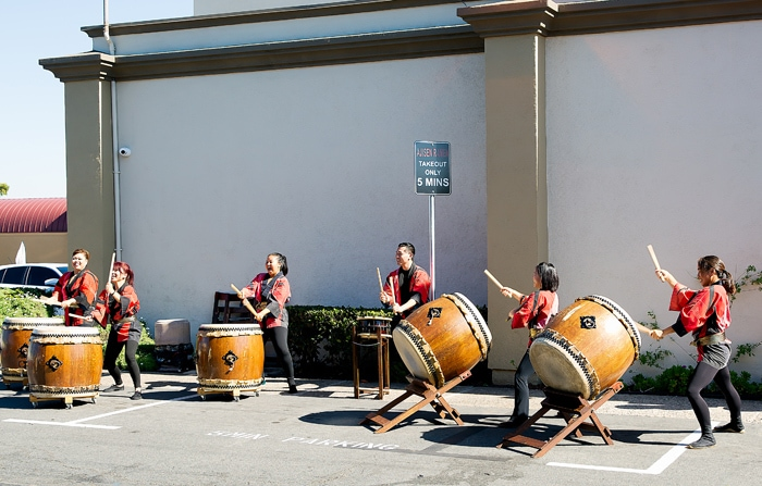 photo of a drum band playing outside Ajisen Ramen