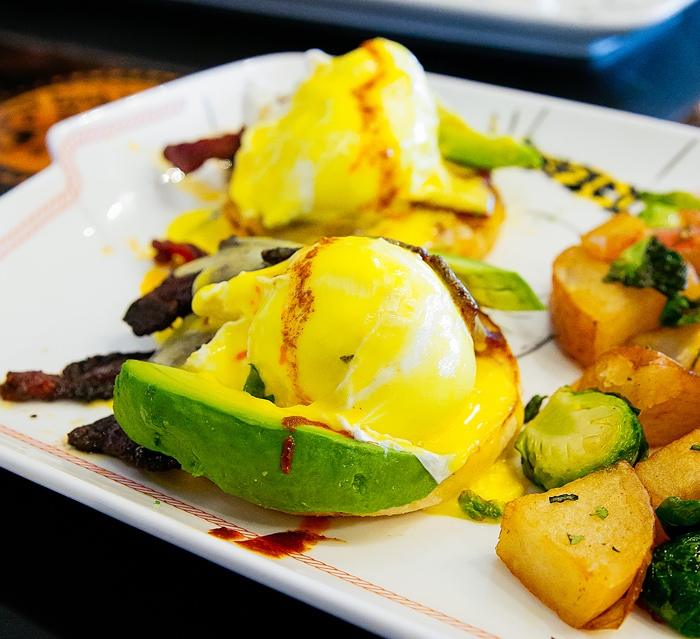 close-up photo of Jurassic Pork Benedict with Avocado