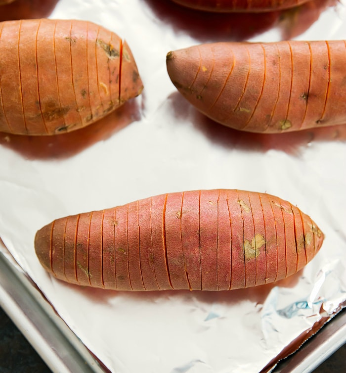 photo showing how to hasselback the sweet potatoes