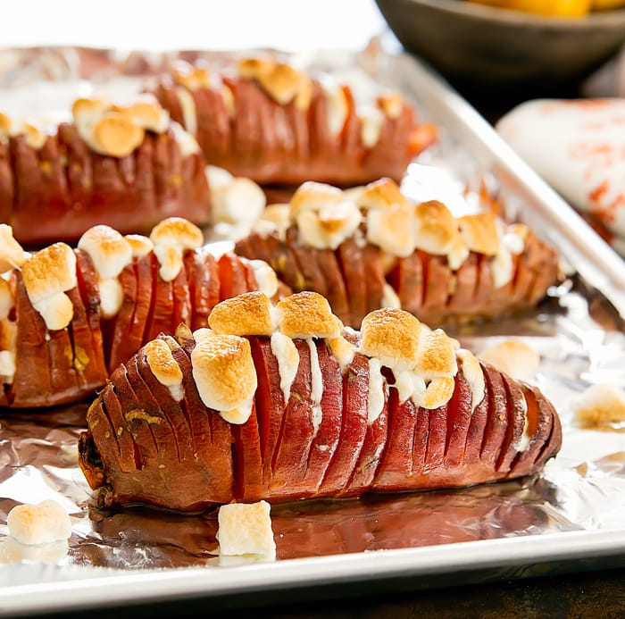 Marshmallow Stuffed Hasselback Sweet Potatoes on a baking sheet