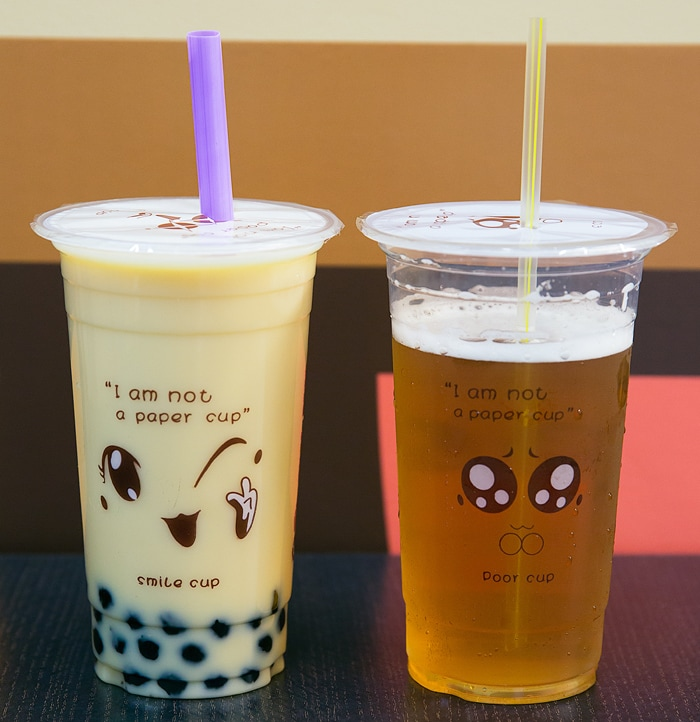 photo of Classic Milk Green Tea with Boba and Osmanthus Oolong drink