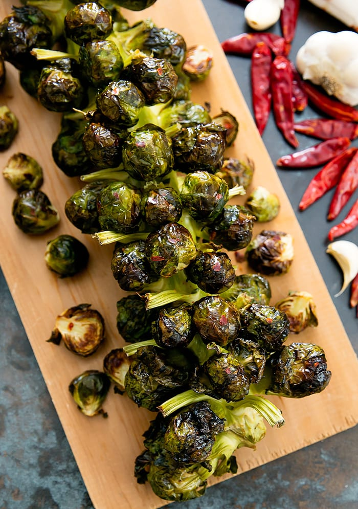 close-up overhead photo of roasted Brussels Sprouts on the Stalk