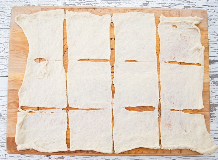 photo of the pizza dough cut into squares