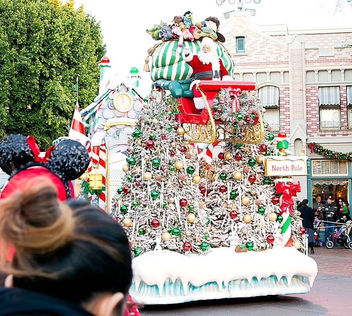 photo of santa riding on a float in the parade