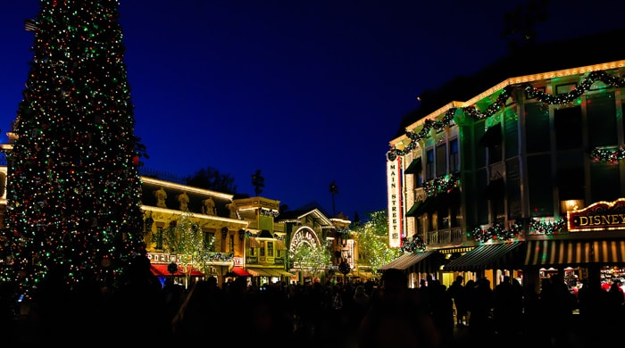 photo of disneyland buildings lit up with lights