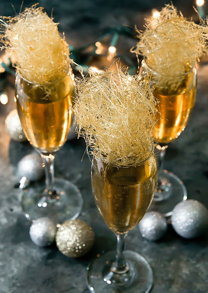 photo of three Champagne Cocktails with gold spun sugar