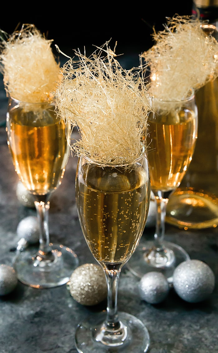 close-up photo of Champagne cocktail with spun sugar