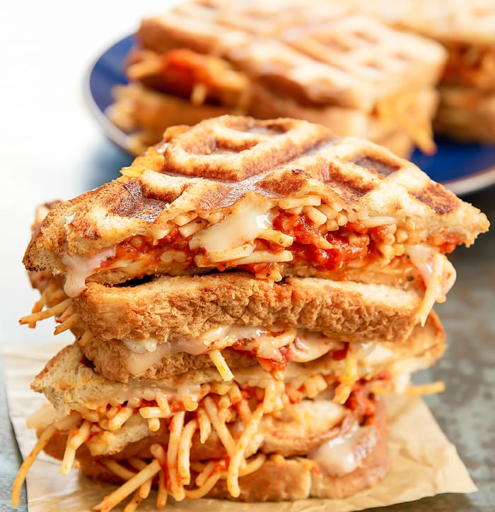 three slices of Spaghetti Grilled Cheese Sandwiches stacked on top of each other
