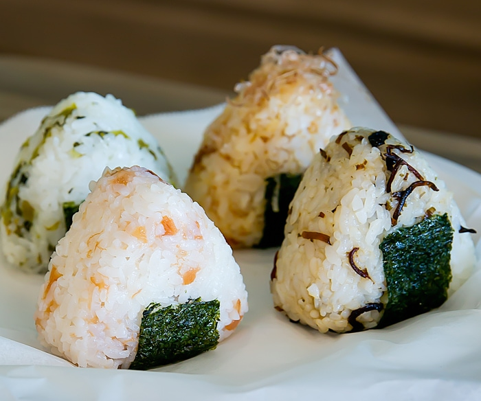 photo of four different  onigiri