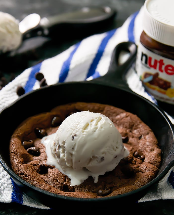 Deep Dish Nutella Skillet Cookie topped with ice cream
