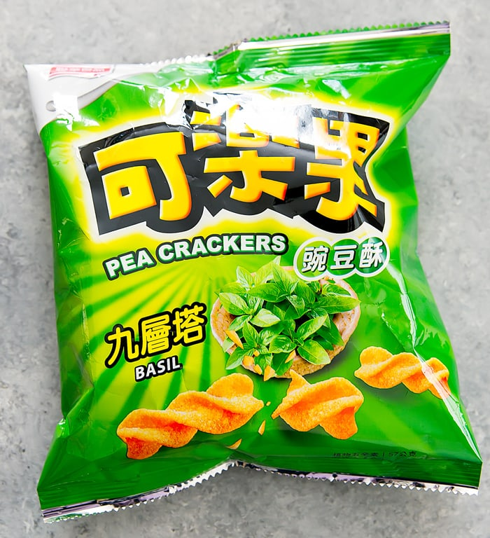 overhead photo of a bag of basil flavored pea crackers/chips