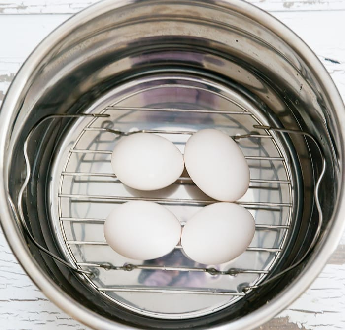 overhead photo of four eggs in an instant pot