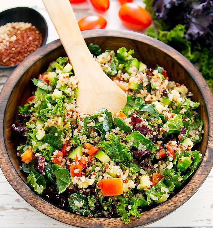 overhead photo of kale quinoa salad with a spoon