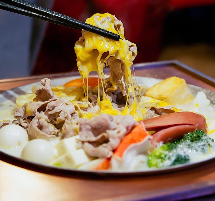 photo of chopstick in Cheesy Milk Hot Pot
