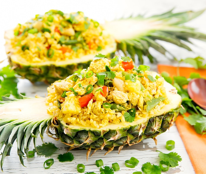photo of Thai Pineapple Cauliflower Fried Rice served in a pineapple