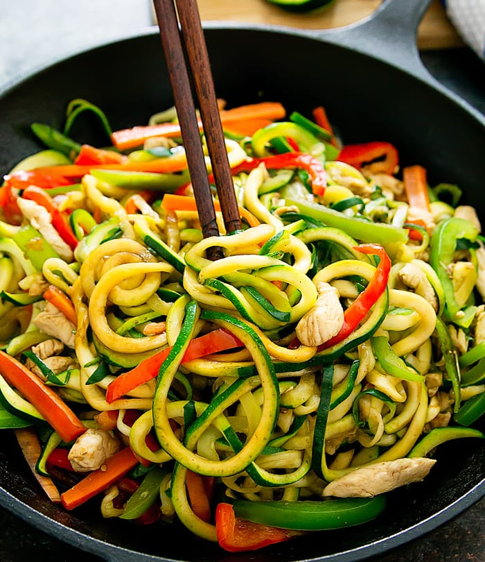 photo of chopsticks grabbing some Stir Fry Zucchini Noodles Chow Mein