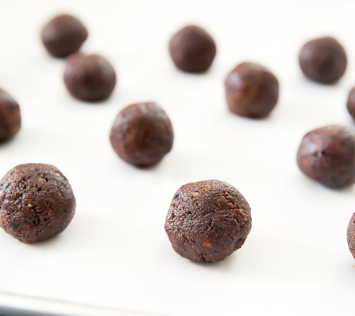 photo of cacao brownie balls on a cookie sheet
