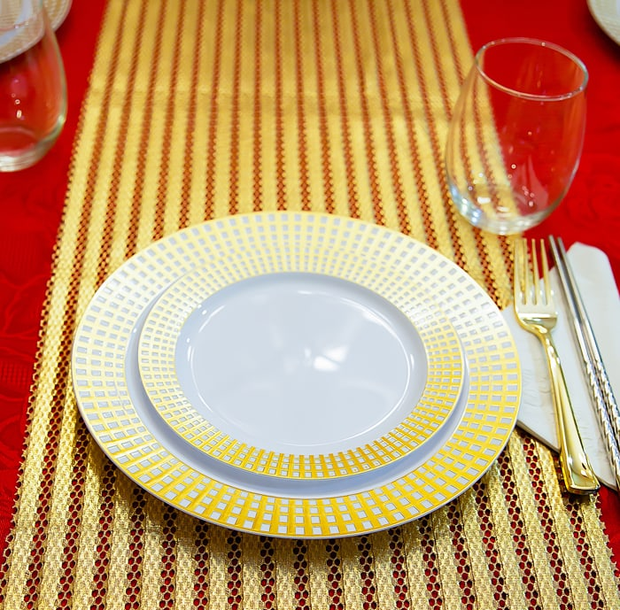 close-up phot of gold-rimmed plates